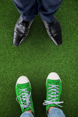well made: Businessman standing isolated on white background against close up view of astro turf Stock Photo