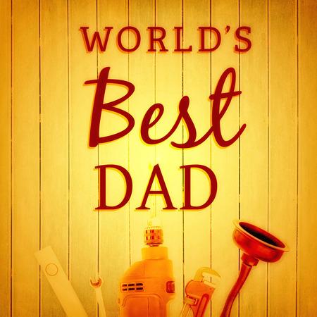 best dad: Worlds best dad against wooden background Stock Photo