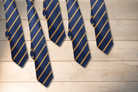 ie: blue tie with diagonal line against bleached wooden planks background