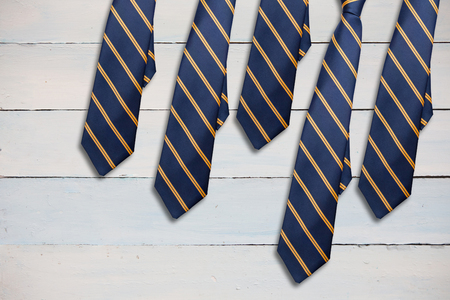 ie: blue tie with diagonal line against painted blue wooden planks Stock Photo