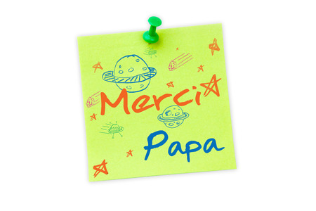 europe closeup: Word merci papa against digital image of pushpin on green paper