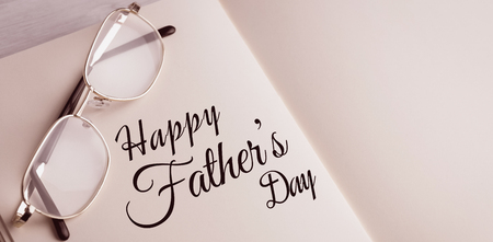 Happy fathers day written on paper on white background