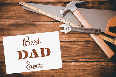 ever: Best dad ever message next to tools on wooden background Stock Photo