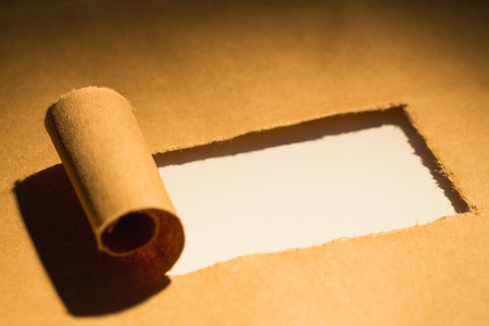 tearing down: Close-up of torn brown paper of box Stock Photo