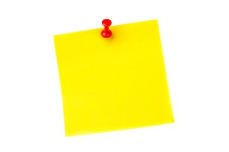 yellow pushpin: Illustrative image of pushpin on yellow paper over white background Stock Photo