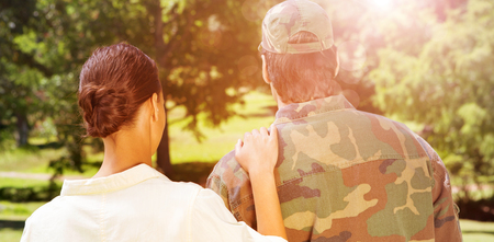 solider: Rear view of solider and wife while leaving from home