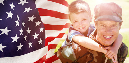 piggyback: Focus on usa FLAG against happy soldier giving piggyback to his son