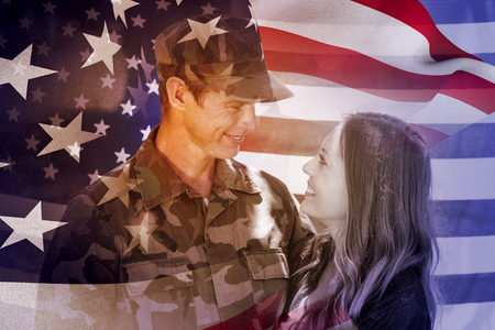 mature adult: Focus on usa FLAG against happy american soldier reunited with his partner Stock Photo
