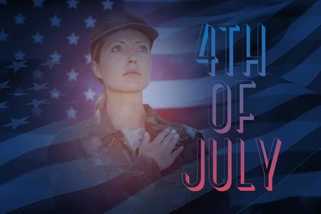 pledge: Waving flag of America against soldier taking pledge