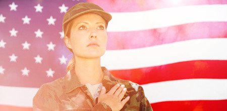 pledge: Soldier taking pledge in front of american flag Stock Photo