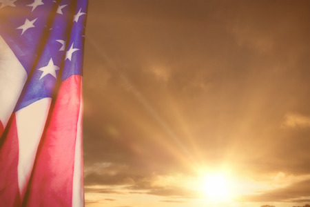 red america: Creased US flag against cloudy sky