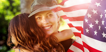 mid adult men: Focus on usa FLAG against a soldier mother hugging her daughter