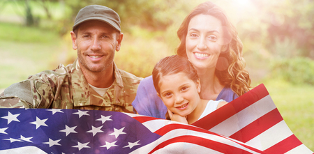 army uniform: Portrait of army man with family against focus on usa flag