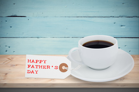 floorboard: Happy fathers day message in front of coffee Stock Photo