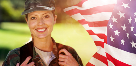 mid adult men: Focus on usa FLAG against happy soldier in the park