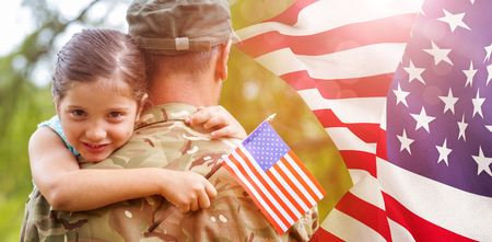tied girl: Portrait of girl hugging army officer father against focus on usa flag Stock Photo