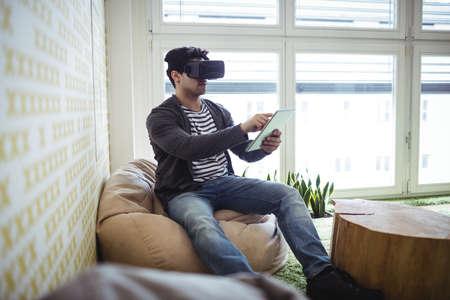 virtual reality simulator: Photo editor using virtual reality simulator and digital tablet in creative office