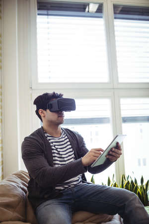 virtual reality simulator: Photo editor using virtual reality simulator with digital tablet in office