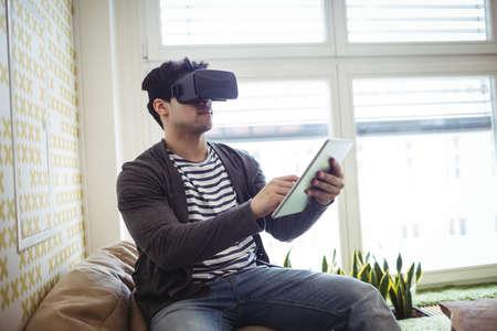 virtual reality simulator: Photo editor using virtual reality simulator and digital tablet in office LANG_EVOIMAGES