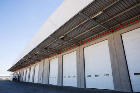 loading bay: Focus on warehouses gathering together outside