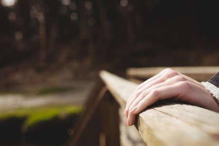 footbridges: focused of hands woman touching footbridge LANG_EVOIMAGES