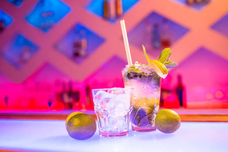 mouth watering: Glasses of drink on counter at nightclub LANG_EVOIMAGES
