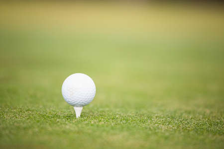pursuits: Close up of a golf ball on the tee LANG_EVOIMAGES