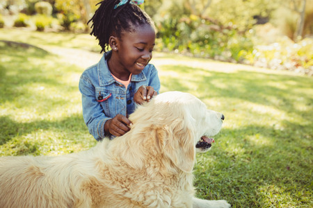 fond of children: Girl posing with her dog at park