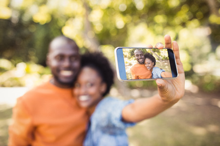fondness: happy couple taking a couple at park Stock Photo