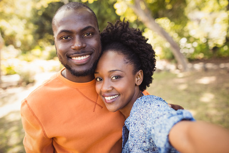fondness: Happy couple posing together at park