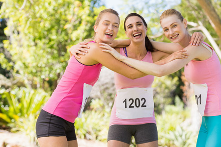 forming: Portrait of young athlete women forming huddles in park Stock Photo