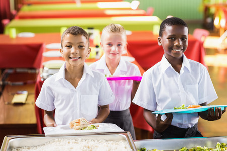 school cafeteria: Portrait of student holding food tray in school cafeteria Stock Photo