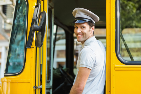 bus driver: Portrait of bus driver smiling while entering in bus