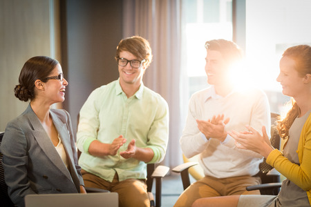 appreciating: Business people clapping hands in the meeting at office