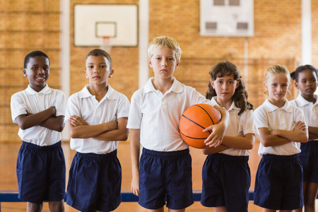 school gym: Students posing with arms crossed in school gym