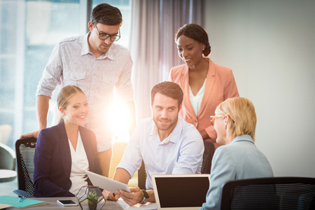 people interacting: Group of business people interacting using digital tablet in the office Stock Photo