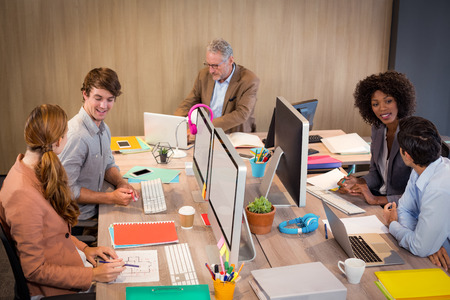 people interacting: Business people interacting with each other in office