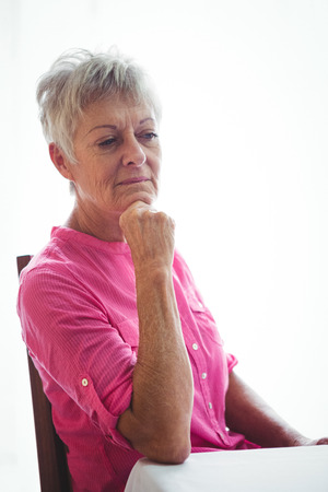 sheltered accommodation: Portrait of a worried senior woman with her elbow on the table