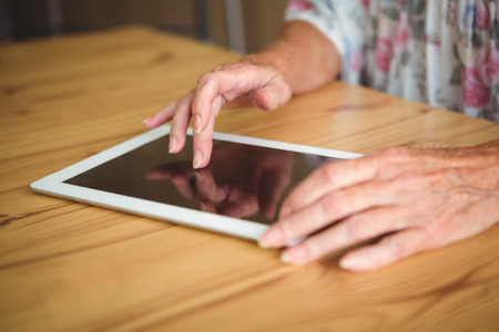 sheltered accommodation: Old person touching a digital tablet on a table