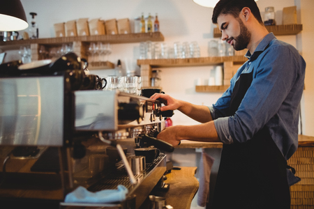 espresso machine: Man taking coffee from espresso machine at office cafeteria Stock Photo