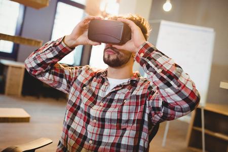 virtual man: Man using virtual reality headset at office