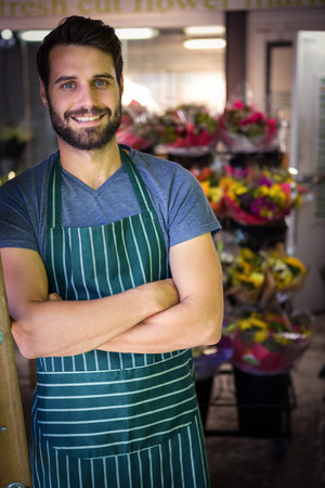 garden staff: Portrait of male florist with arms crossed in flower shop