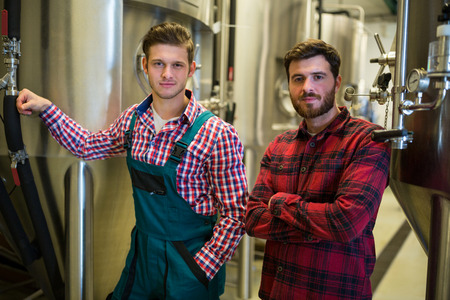food plant: Portrait of brewers with arms crossed at brewery