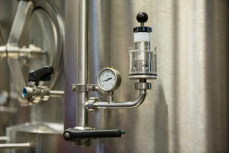 barometer: Close-up of barometer at brewery factory Stock Photo