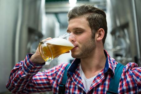 brewery: Brewer testing beer at brewery factory