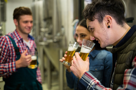 brewers: Brewers testing beer at brewery factory