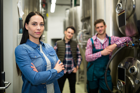 brewers: Portrait of brewers posing at brewery factory