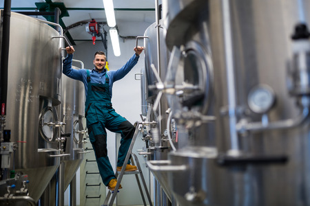 maintenance worker: Portrait of happy maintenance worker at brewery Stock Photo