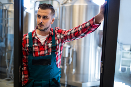 thinking machines: Thoughtful brewer standing at brewery Stock Photo
