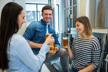 brewers: Happy brewers having beer at brewery